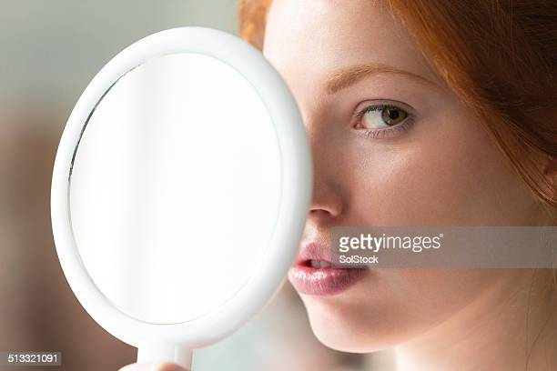 Young Woman Holding Mirror
