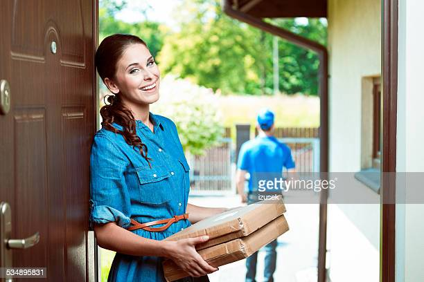Young woman holding packages