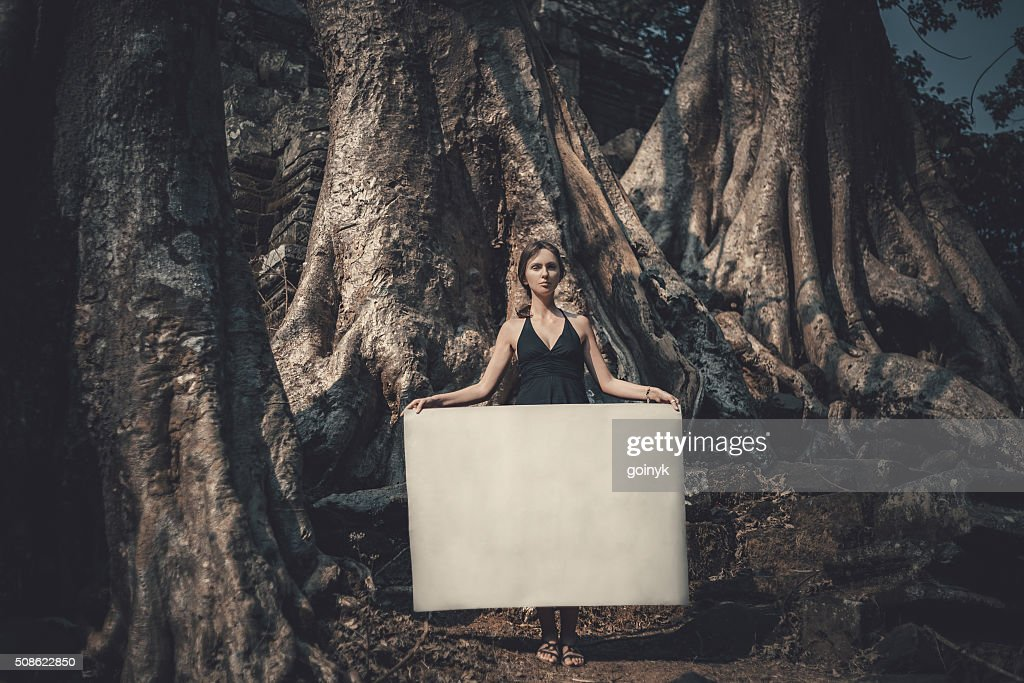 Young woman holding paper : Stock Photo