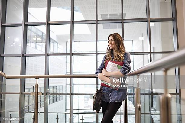 Young woman holding paperwork