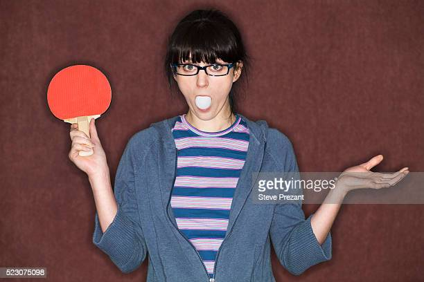 young woman holding ping pong paddle - funny ping pong stock pictures, royalty-free photos & images