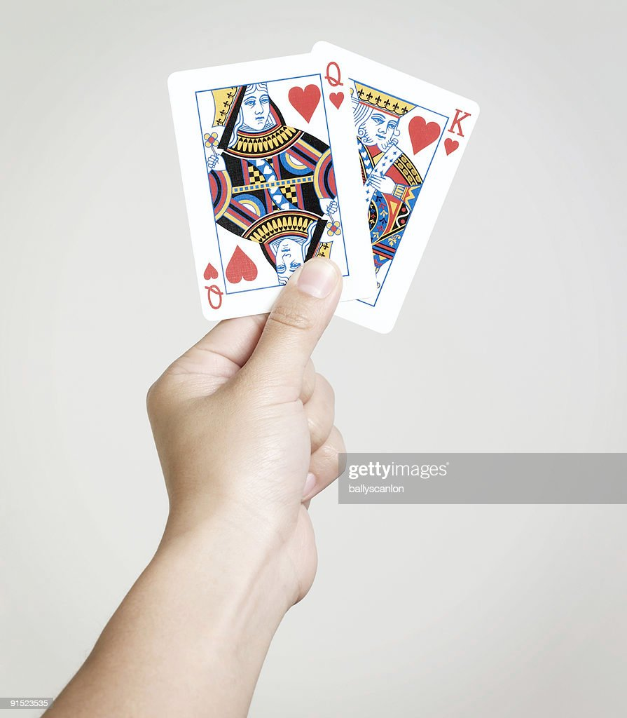 Young woman holding playing cards  : Stock Photo