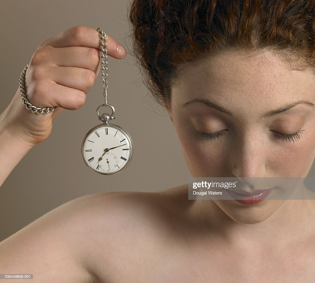 Young Woman Holding Pocket Watch Eyes Closed Close Up