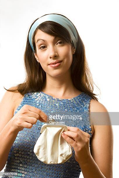young woman holding purse - miserly stock pictures, royalty-free photos & images