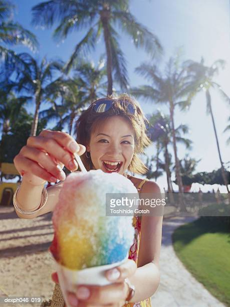 Young woman holding shaved ice