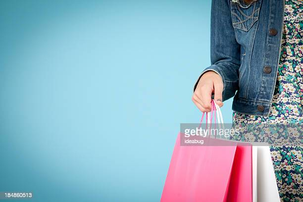 Young Woman Holding Shopping Bags, With Room for Text