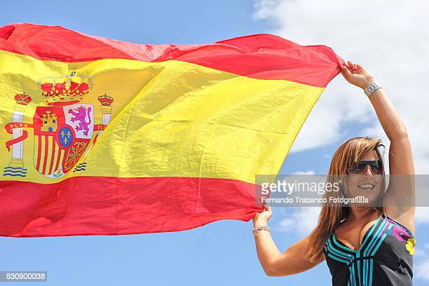 Young woman holding Spanish flag