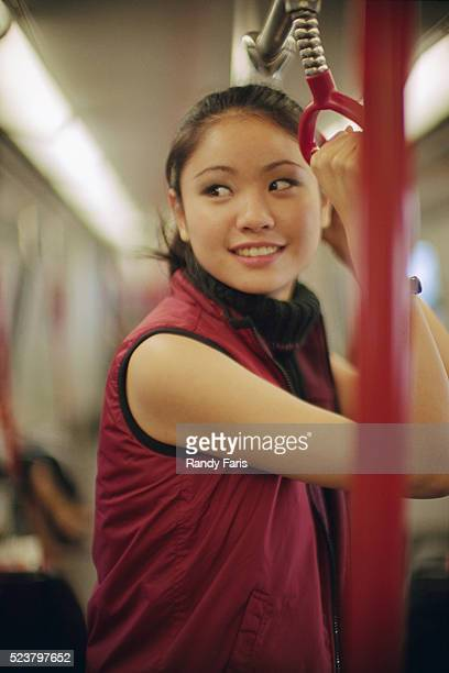 Young Woman Holding Subway Handle