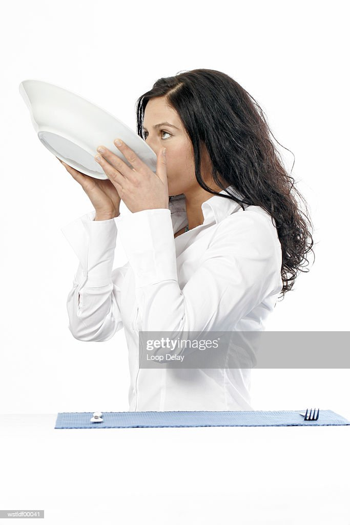 Young woman holding the bowl : Stock Photo