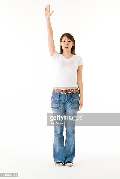 Young woman holding up hand