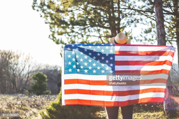 Young woman holding USA flag