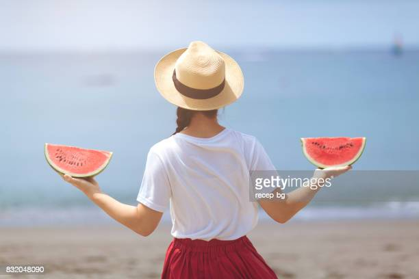 young woman holding watermelon - japanese girls hot stock photos and pictures