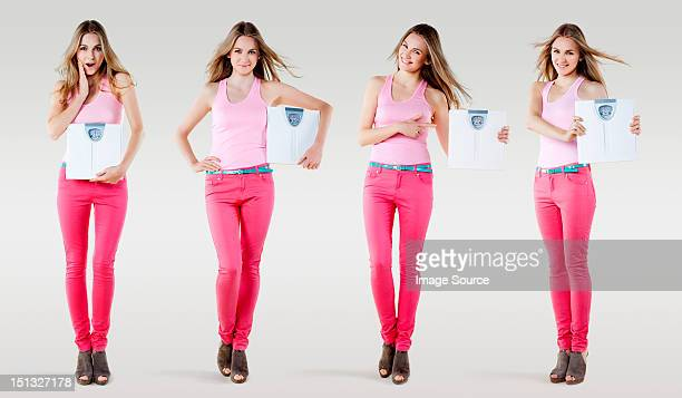 Young woman holding weighing scales, composite