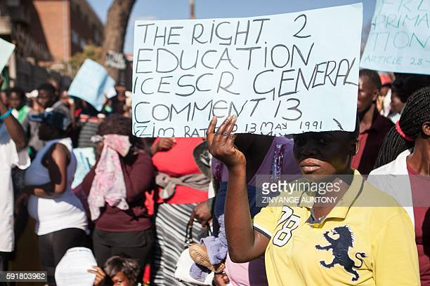 A young woman holds a placard during a march for free basic education on August 17 in Bulawayo As president Robert Mugabe's cashstrapped government...