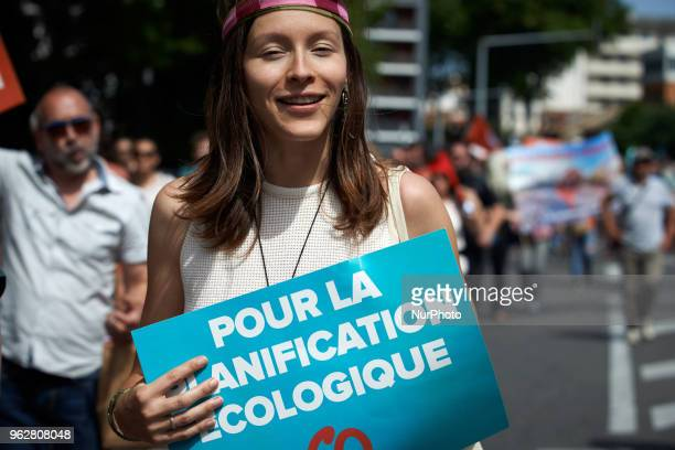 A young woman holds a placard reading 'For an ecological planning' A quotmaree populairequot demonstration was called by more than 60 political...