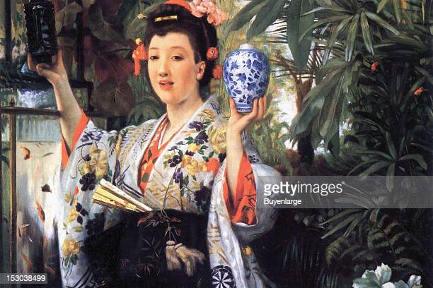 A young woman holds Japanese porcelain vases 1865 By James Tissot