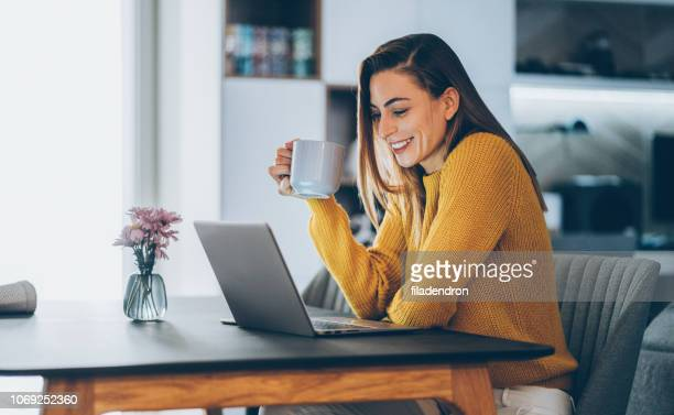 young woman home office - remote work stock pictures, royalty-free photos & images