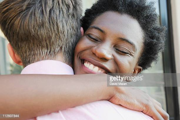 young woman hugging a man.
