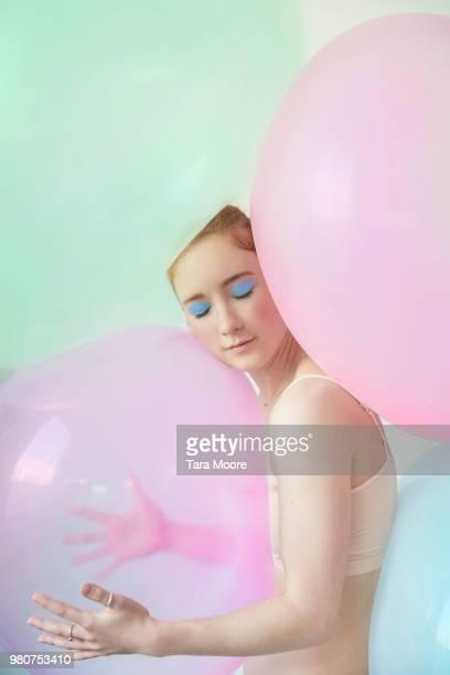 young woman hugging balloon