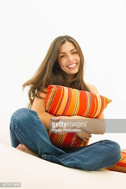 Young Woman Hugging Cushion