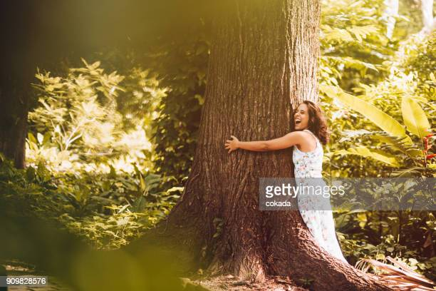 Young woman hugging the tree