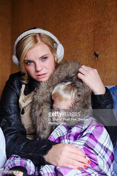 Young woman hugging toddler boy in Winter Coat