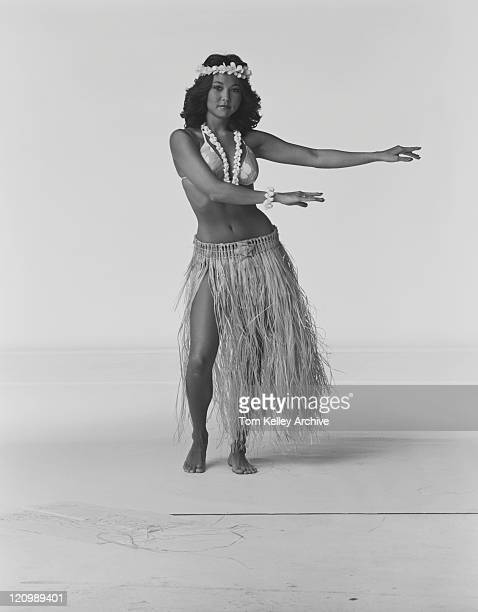 Young woman hula dancer dancing on white background, portrait