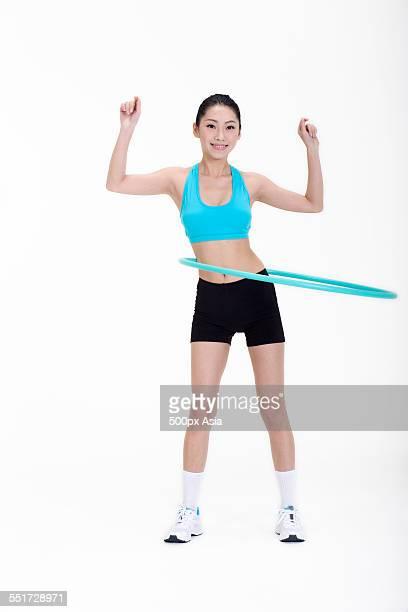 Young Woman Hula Hooping