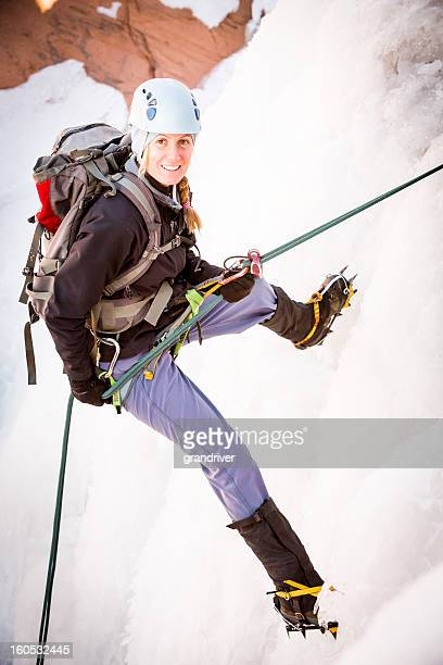 Young Woman Ice Climbing