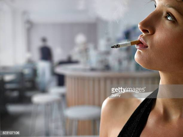 Young Woman in a Bar Smoking