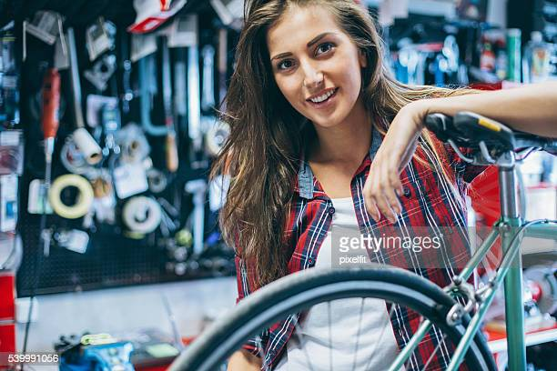 Young woman in a bike repair shop