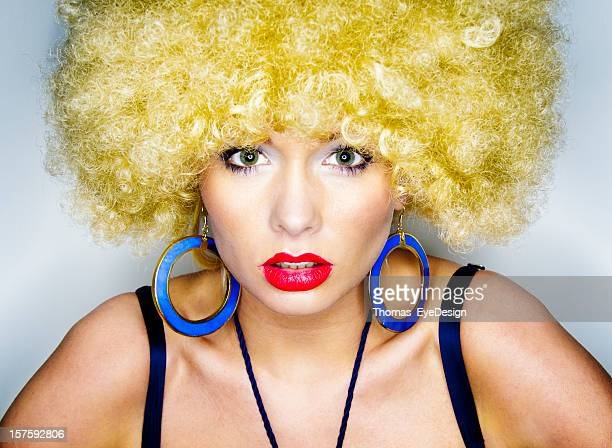 young woman in a blond afro wig - hoop earring stock pictures, royalty-free photos & images