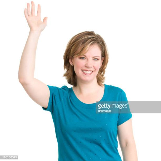 Young woman in a blue tee raising her hand to ask a question
