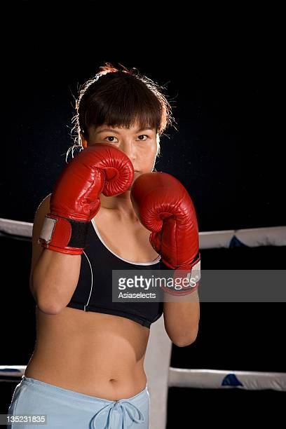 young woman in a boxing ring - belly punching stock pictures, royalty-free photos & images