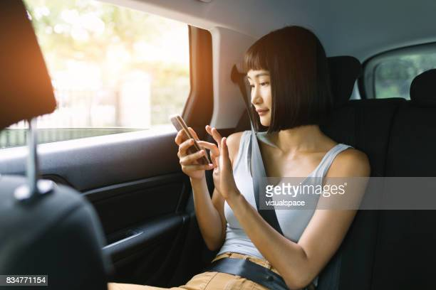 young woman in a car - car pooling stock photos and pictures