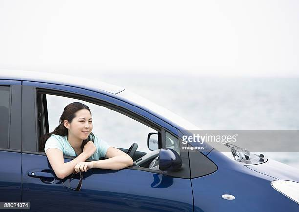 A young woman in a car