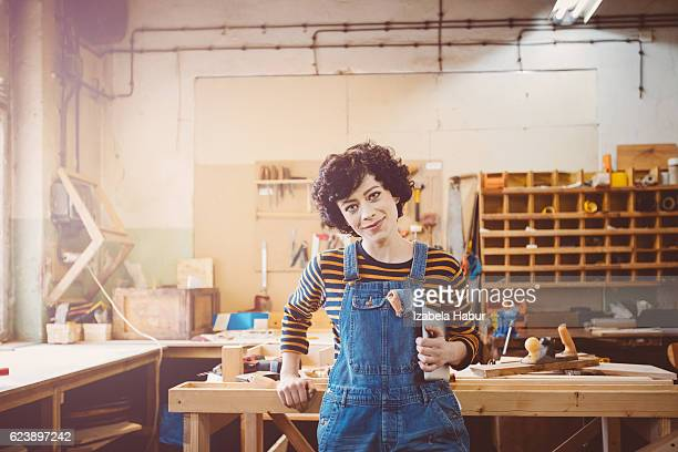 Young woman in a carentry workshop