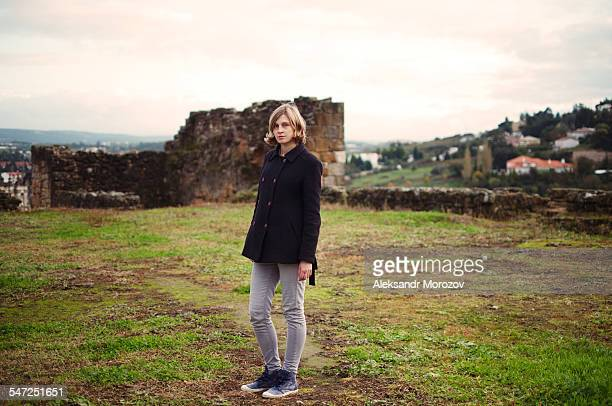 young woman in a coat on a hill - leiria district stock photos and pictures