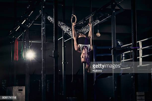 Young woman in a cross training rack
