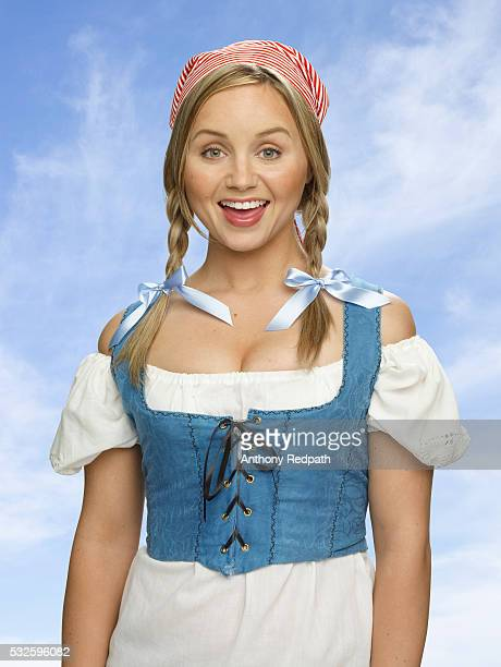 Young woman in a dirndl and braids