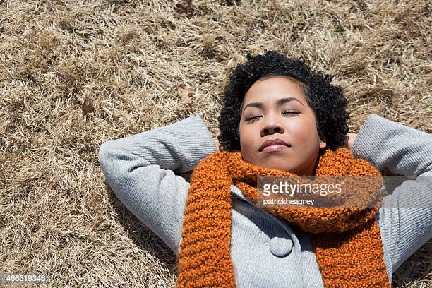 Young Woman in a Field of Brown Grass