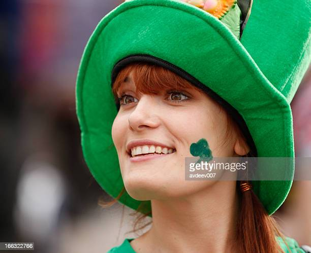 A young woman, in a green hat, celebrating St Patrick's Day