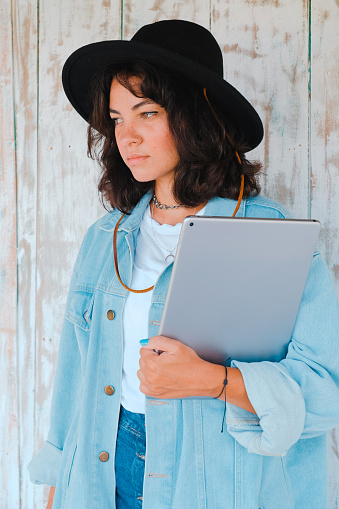 Young woman in a hat with a laptop - gettyimageskorea