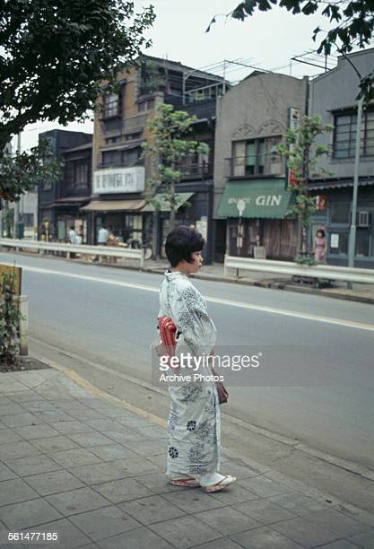 A young woman in a kimono and obi on a street in Tokyo Japan 1967