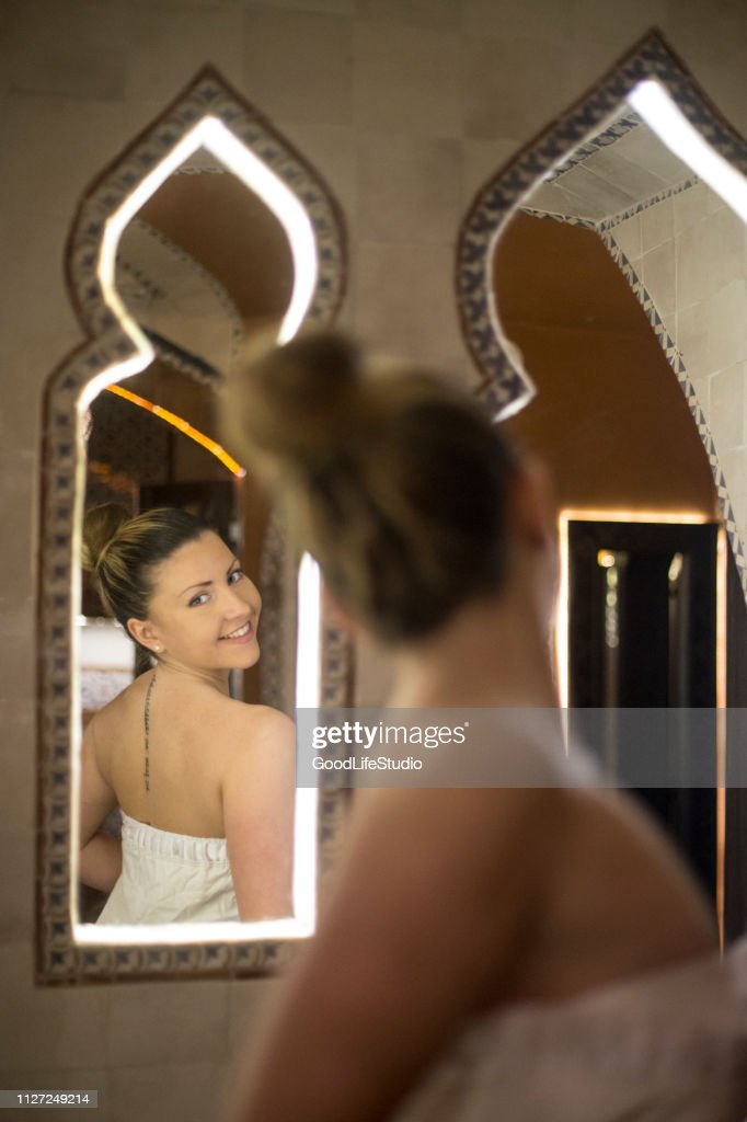 Young woman in a oriental steam sauna : Stock Photo