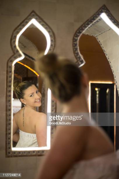 young woman in a oriental steam sauna - mirror steam stock photos and pictures