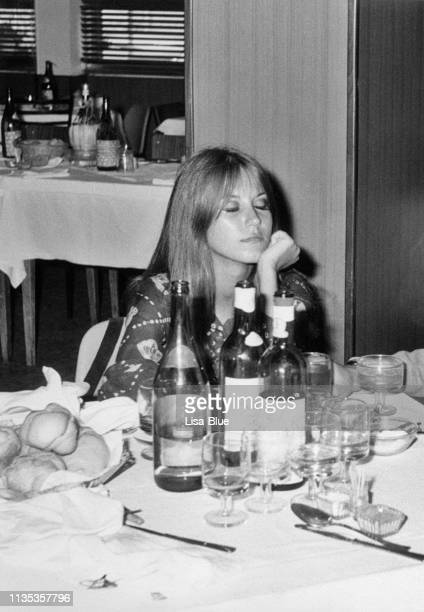 young woman in a restaurant in 1968 - vintage restaurant stock pictures, royalty-free photos & images