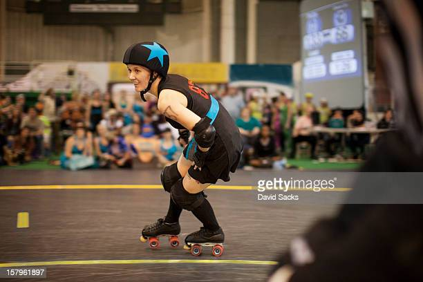 Young woman in a roller derby bout