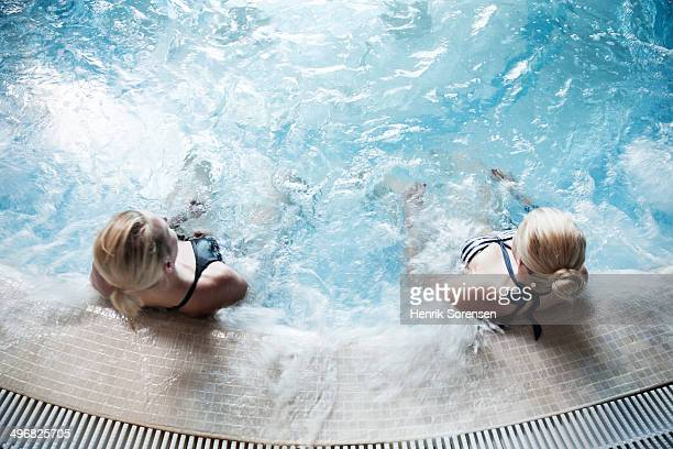 2 young woman in a spa pool