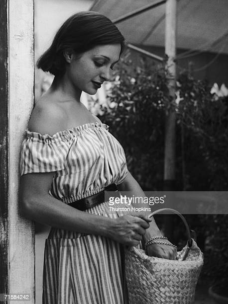 A young woman in a striped offtheshoulder dress at Paraggi Beach near Portofino Italy August 1952 Original publication Picture Post 6023 Italian...